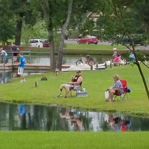 People fishing and playing at a pond in Canton, TX