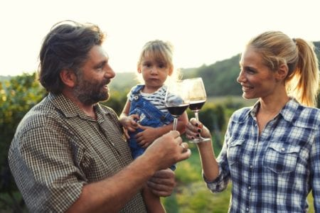 Photo of a Couple Toasting With Their Child at One of the Best East Texas Wineries